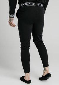 SIKSILK - LOUNGE PANTS - Teplákové kalhoty - black - 2