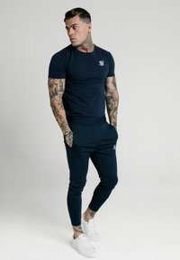 SIKSILK - AGILITY TRACK PANTS - Pantalon de survêtement - navy - 1