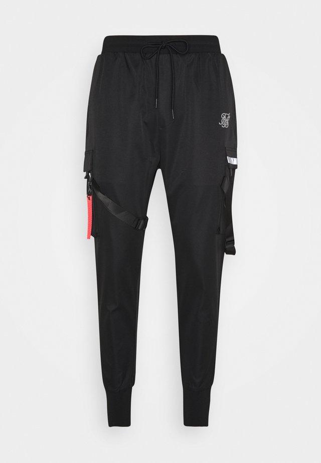 COMBAT TECH PANTS - Cargo trousers - black