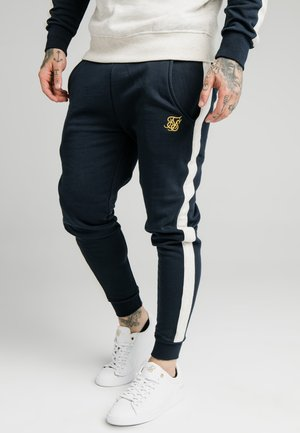 CUT AND SEW JOGGERS - Tracksuit bottoms - navy/cream