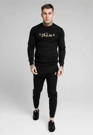 SIGNATURE TRACK PANTS - Pantalon de survêtement - black