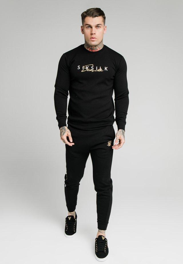 SIGNATURE TRACK PANTS - Tracksuit bottoms - black
