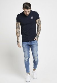 SIKSILK - DISTRESSED SUPER  - Jeansy Skinny Fit - mid wash denim