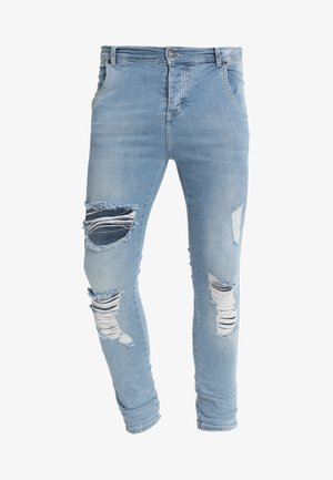 DISTRESSED SUPER - Skinny-Farkut - light wash denim