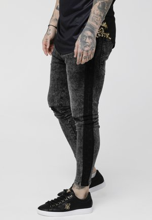 LOW RISE CARTEL - Jeans Skinny Fit - black acid wash