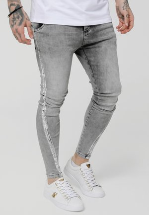 PAINT STRIPE TWISTED HEM - Jeans Skinny Fit - snow wash