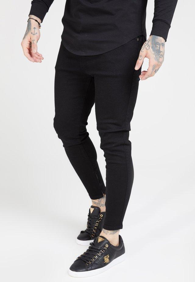 Stoffhose - black