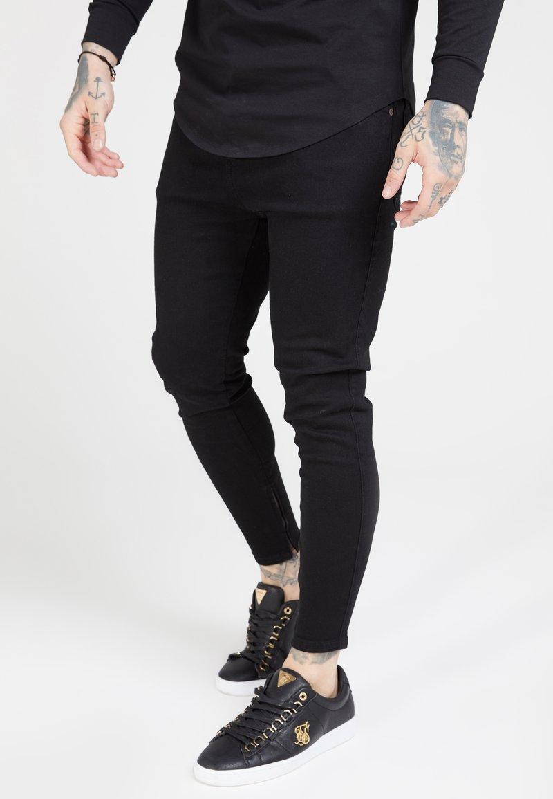 SIKSILK - Trousers - black