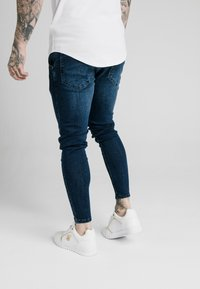 SIKSILK - SKINNY  - Jeans Tapered Fit - indigo - 2
