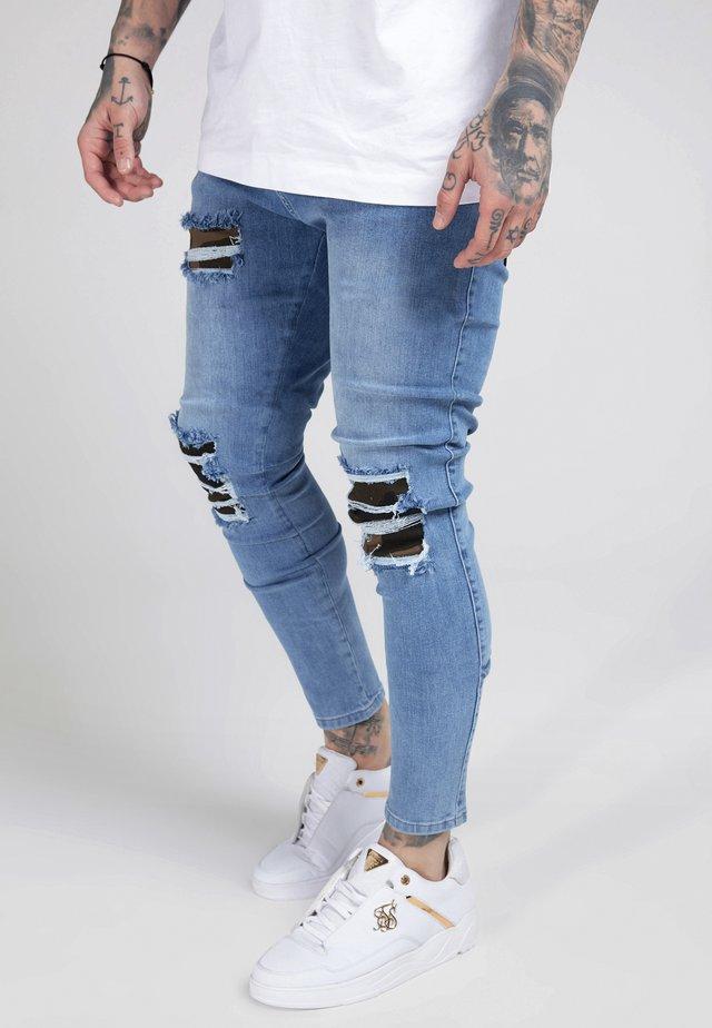 BURST KNEE LOW RISE - Jeans Skinny Fit - midstone