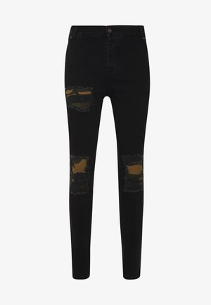 BURST KNEE LOW RISE - Vaqueros pitillo - washed black