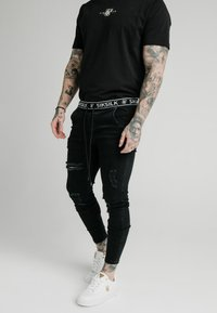 SIKSILK - ELASTICATED WAIST DISTRESSED - Jeans Skinny Fit - black - 0