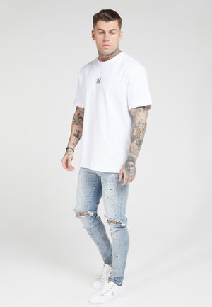 BUST KNEE RIOT - Skinny-Farkut - light blue