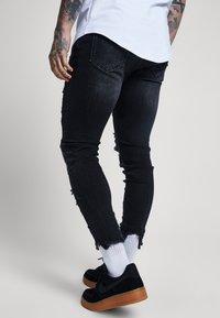 SIKSILK - RAW CUFF CROPPED - Jeans Skinny Fit - black - 4