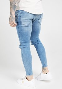 SIKSILK - DISTRESSED SLICE KNEE - Jeans Skinny - midstone blue - 2