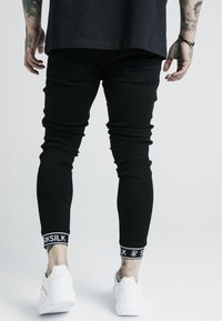 SIKSILK - X DANI ALVES TECH CUFF  - Jeans Skinny Fit - black