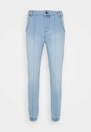 CUFFED - Jeans Tapered Fit - light blue