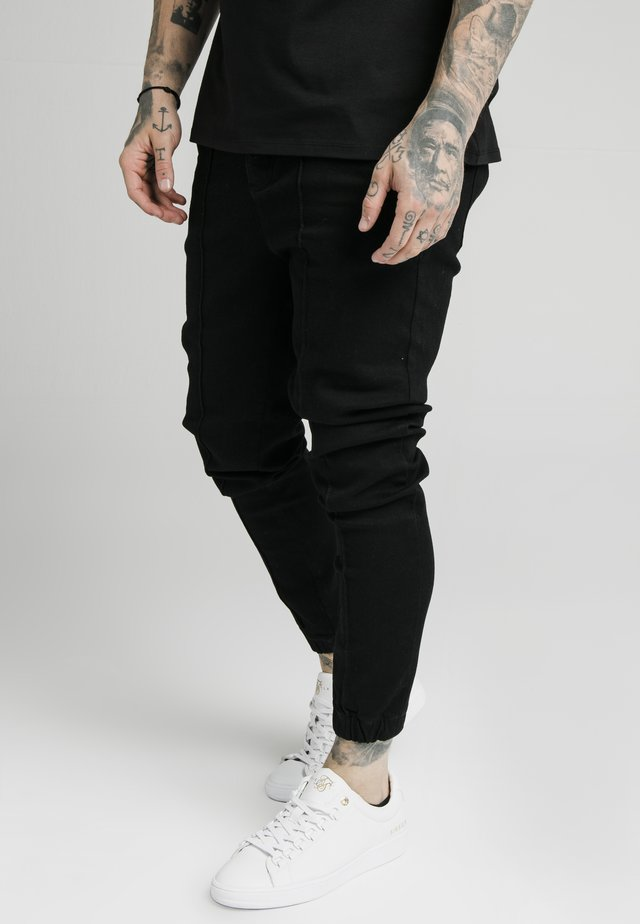 CUFFED - Jeans Tapered Fit - black