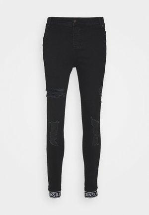 SKINNY CUFFED JEANS - Jeans Skinny Fit - black