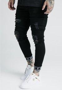 SIKSILK - SKINNY CUFFED JEANS - Jeans Skinny Fit - black - 4