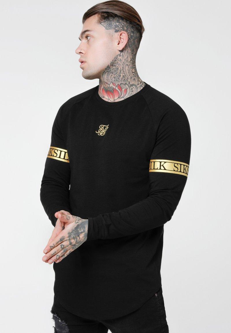 SIKSILK - LONG SLEEVE TECH TEE - Long sleeved top - black