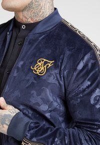 SIKSILK - DEBOSSED  - Training jacket - navy
