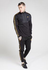 SIKSILK - EVOLUTION HALF ZIP TRACK TOP - Lehká bunda - black & gold - 1