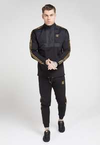 SIKSILK - EVOLUTION HALF ZIP TRACK TOP - Giacca leggera - black & gold