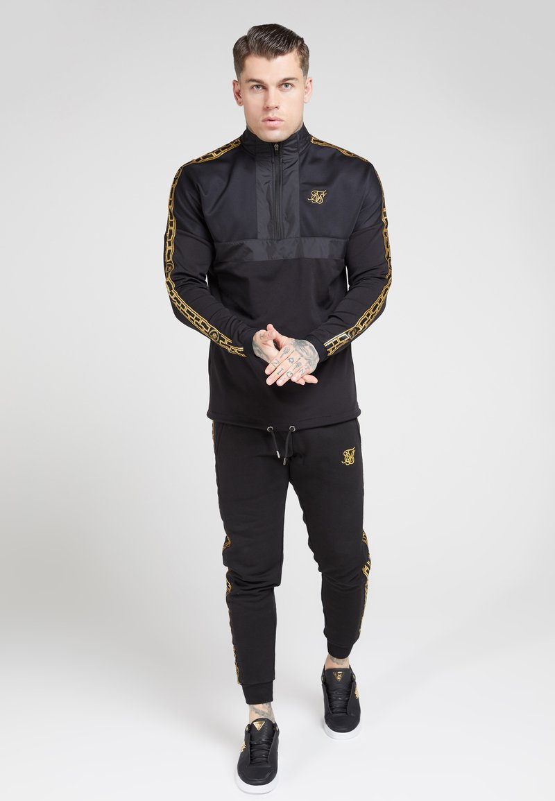 SIKSILK - EVOLUTION HALF ZIP TRACK TOP - Lehká bunda - black & gold