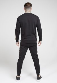 SIKSILK - EVOLUTION HALF ZIP TRACK TOP - Lehká bunda - black & gold - 2