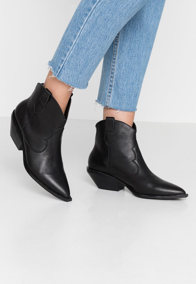 NADIA - Cowboy/biker ankle boot - black