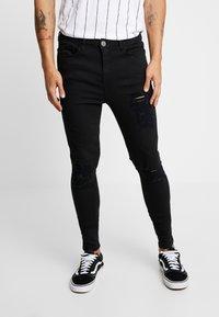 SINNERS ATTIRE - REPAIR JEANS - Jeans Skinny Fit - black - 0