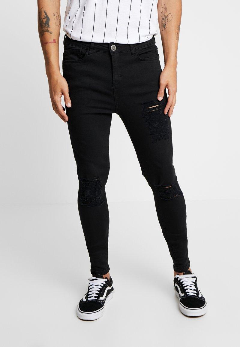 SINNERS ATTIRE - REPAIR JEANS - Jeans Skinny Fit - black