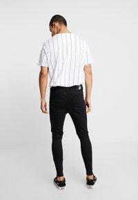 SINNERS ATTIRE - REPAIR JEANS - Jeans Skinny Fit - black - 2