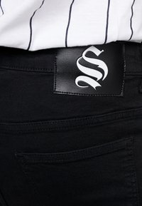 SINNERS ATTIRE - REPAIR JEANS - Jeans Skinny Fit - black - 4