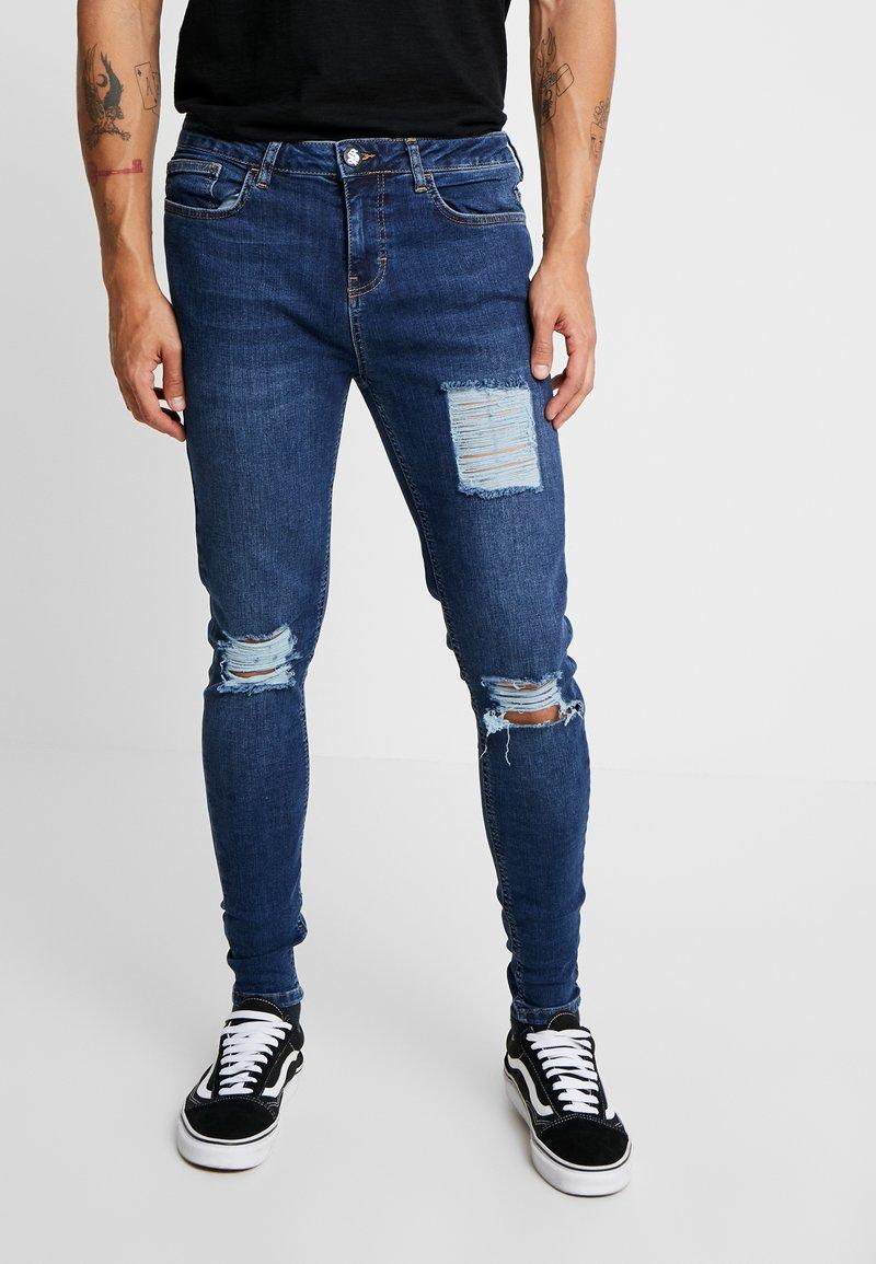 SINNERS ATTIRE - RIP REPAIR JEANS - Jeans Skinny Fit - darkwash