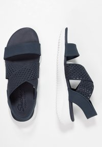 Skechers - ULTRA FLEX - Wedge sandals - navy - 3