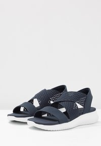 Skechers - ULTRA FLEX - Wedge sandals - navy - 4