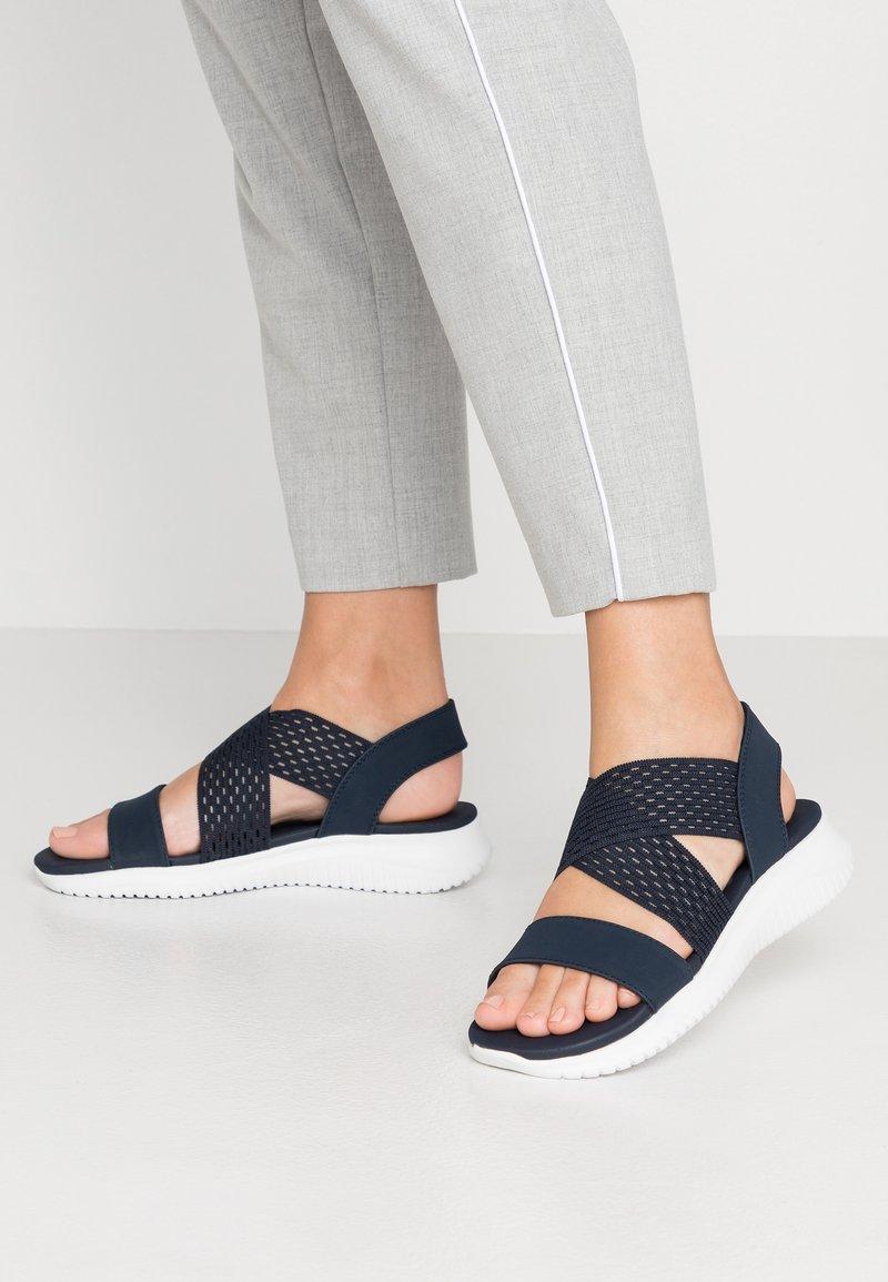 Skechers - ULTRA FLEX NEON STAR - Wedge sandals - navy