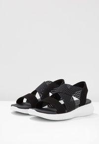 Skechers - ULTRA FLEX - Wedge sandals - black - 4