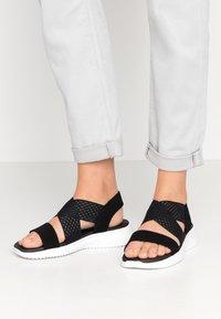 Skechers - ULTRA FLEX - Wedge sandals - black - 0