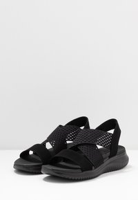 Skechers - ULTRA FLEX - Wedge sandals - black - 4