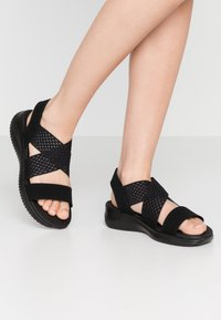 Skechers - ULTRA FLEX - Wedge sandals - black - 0
