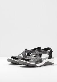 Skechers - REGGAE CUP - Vaellussandaalit - black/grey gore - 4