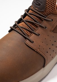 Skechers - DELSON AXTON - Slip-ons - dark brown - 5