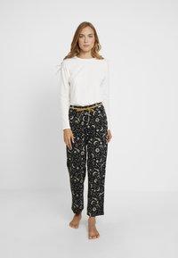 Skiny - EMPOWERED SLEEP - Pyjama bottoms - black - 1