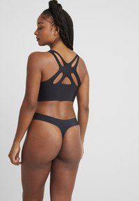 Sloggi - String - black - 2