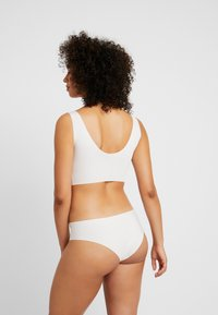 Sloggi - FEEL TANGA - Braguitas - off-white
