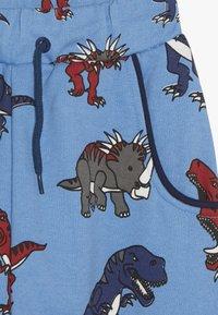 Småfolk - PANTS WITH DINOSAURS - Pantalon de survêtement - winter blue - 3