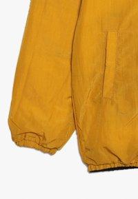 Smitten Organic - SNOW JACKET BABY  - Bunda zprachového peří - amber yellow/orion blue - 4